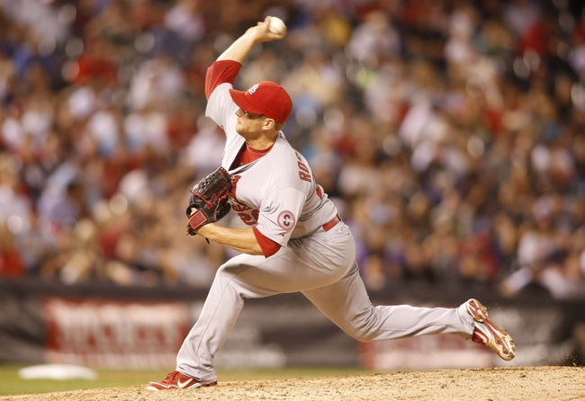 Sep 18, 2013; Denver, CO, USA; St. Louis Cardinals pitcher Trevor Rosenthal delivers a pitch during the eighth inning against the Colorado Rockies at Coors Field. The Cardinals won 4-3.  Mandatory Credit: Chris Humphreys-USA TODAY Sports