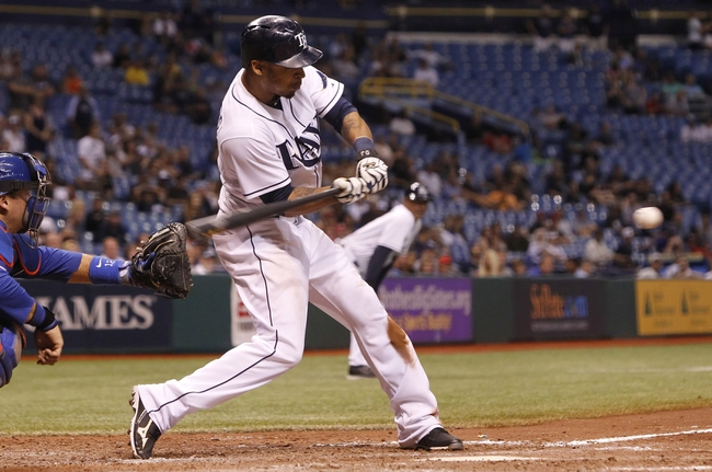 Sep 18, 2013; St. Petersburg, FL, USA; Tampa Bay Rays center fielder Desmond Jennings (8) hits the game winning RBI single during the twelfth inning against the Texas Rangers at Tropicana Field. Tampa Bay Rays defeated the Texas Rangers 4-3 in twelve innings. Mandatory Credit: Kim Klement-USA TODAY Sports