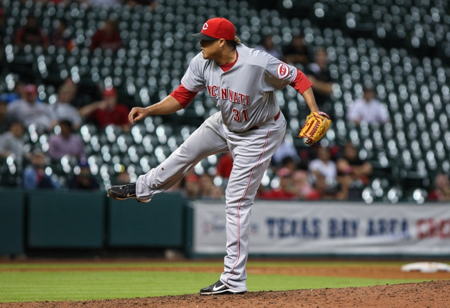 Sep 18, 2013; Houston, TX, USA; Cincinnati Reds relief pitcher Alfredo Simon (31) pitches during the tenth inning against the Houston Astros at Minute Maid Park. Mandatory Credit: Troy Taormina-USA TODAY Sports