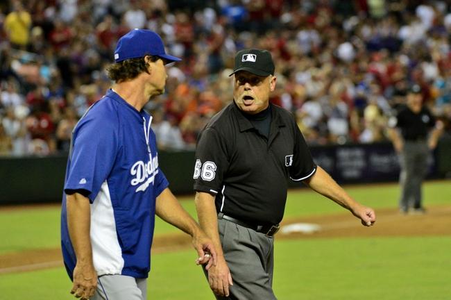 Sep 18, 2013; Phoenix, AZ, USA; Los Angeles Dodgers manager Don Mattingly (8) argues with MLB umopire Jim Joyce during the sixth inning against the Arizona Diamondbacks at Chase Field. Mandatory Credit: Matt Kartozian-USA TODAY Sports