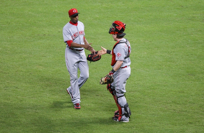 Sep 18, 2013; Houston, TX, USA; Cincinnati Reds relief pitcher Aroldis Chapman (54) is congratulated by catcher Ryan Hanigan (29) after defeating the Houston Astros 6-5 at Minute Maid Park. Mandatory Credit: Troy Taormina-USA TODAY Sports