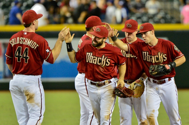 Sep 18, 2013; Phoenix, AZ, USA; members of the Arizona Diamondbacks celebrate after beating the Los Angeles Dodgers 9-4 at Chase Field. Mandatory Credit: Matt Kartozian-USA TODAY Sports