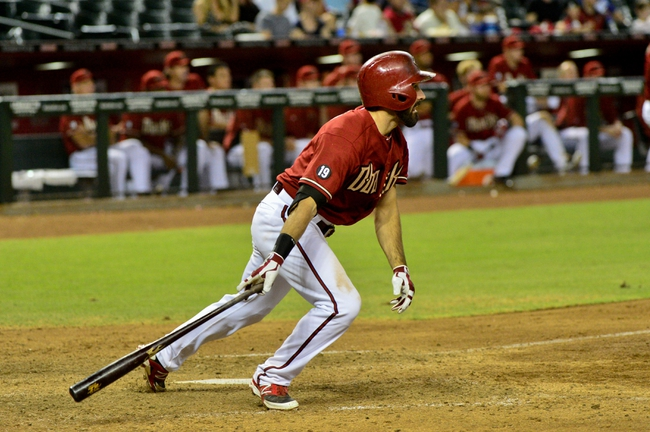Sep 18, 2013; Phoenix, AZ, USA; Arizona Diamondbacks left fielder Adam Eaton (6) hits a 2 RBI single during the eighth inning against the Los Angeles Dodgers at Chase Field. Mandatory Credit: Matt Kartozian-USA TODAY Sports