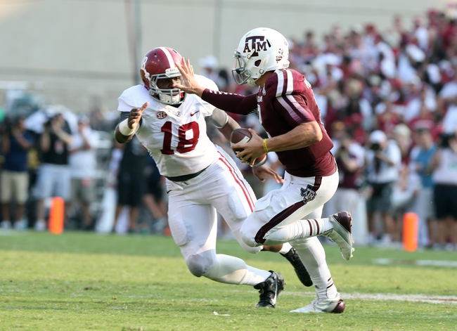 Sep 14, 2013; College Station, TX, USA; Texas A&M Aggies  quarterback Johnny Manziel (2) stiff arms in the