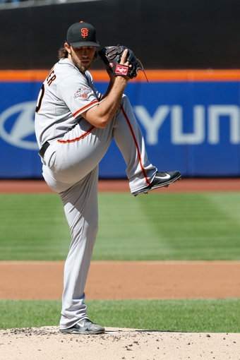 Sep 19, 2013; New York, NY, USA;  San Francisco Giants starting pitcher Madison Bumgarner (40) pitches during the first inning against the New York Mets at Citi Field. Mandatory Credit: Anthony Gruppuso-USA TODAY Sports