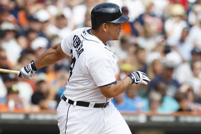 Sep 18, 2013; Detroit, MI, USA; Detroit Tigers third baseman Miguel Cabrera (24) hits a single in the third inning against the Seattle Mariners at Comerica Park. Mandatory Credit: Rick Osentoski-USA TODAY Sports