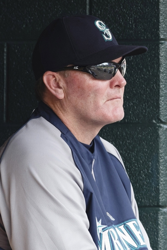 Sep 18, 2013; Detroit, MI, USA; Seattle Mariners manager Eric Wedge (22) watches from the dugout in the third inning against the Detroit Tigers at Comerica Park. Mandatory Credit: Rick Osentoski-USA TODAY Sports