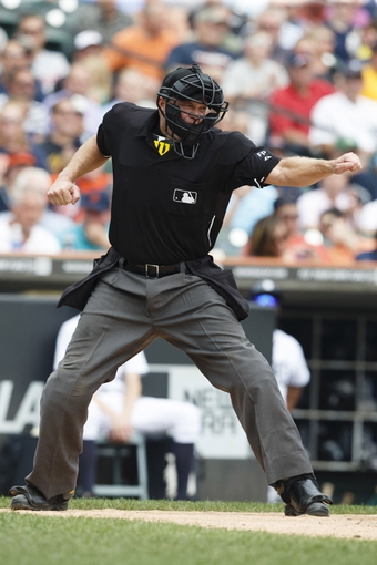 Sep 18, 2013; Detroit, MI, USA; Home plate umpire Ron Kulpa calls Seattle Mariners second baseman Nick Franklin (not pictured) out on strikes in the fourth inning against the Detroit Tigers at Comerica Park. Mandatory Credit: Rick Osentoski-USA TODAY Sports