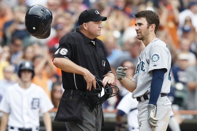 Sep 18, 2013; Detroit, MI, USA; Seattle Mariners second baseman Nick Franklin (20) tosses his helmet after he is called out on strike by home plate umpire Ron Kulpa in the fourth inning against the Detroit Tigers at Comerica Park. Mandatory Credit: Rick Osentoski-USA TODAY Sports