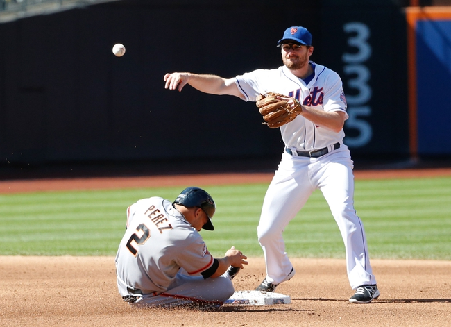 Sep 19, 2013; New York, NY, USA;  New York Mets second baseman Daniel Murphy (28) has San Francisco Giants left fielder Juan Perez (2) during the fourth inning at Citi Field. Mandatory Credit: Anthony Gruppuso-USA TODAY Sports