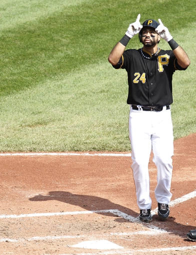 Sep 19, 2013; Pittsburgh, PA, USA; Pittsburgh Pirates third baseman Pedro Alvarez (24) reacts at home plate after hitting a solo home run against the San Diego Padres during the fourth inning at PNC Park. Mandatory Credit: Charles LeClaire-USA TODAY Sports