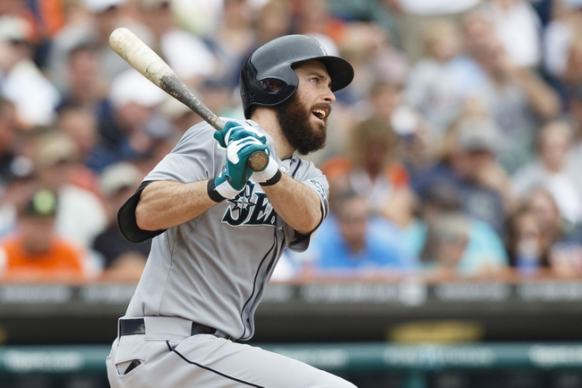 Sep 18, 2013; Detroit, MI, USA; Seattle Mariners center fielder Dustin Ackley (13) hits a three run home run in the fifth inning against the Detroit Tigers at Comerica Park. Mandatory Credit: Rick Osentoski-USA TODAY Sports
