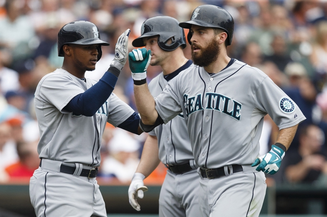 Sep 18, 2013; Detroit, MI, USA; Seattle Mariners center fielder Dustin Ackley (right) receive congratulation from short stop Carlos Triunfel (left) and catcher Mike Zunino (3) after he hits a three run home run in the fifth inning against the Detroit Tigers at Comerica Park. Mandatory Credit: Rick Osentoski-USA TODAY Sports