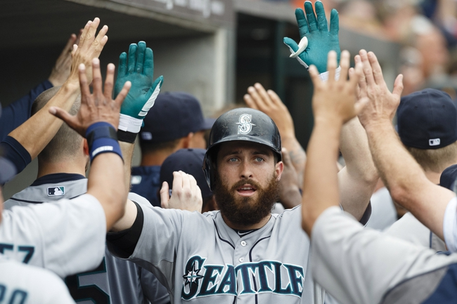 Sep 18, 2013; Detroit, MI, USA; Seattle Mariners center fielder Dustin Ackley (13) congratulated by teammates after he hits a three run home run in the fifth inning against the Detroit Tigers at Comerica Park. Mandatory Credit: Rick Osentoski-USA TODAY Sports