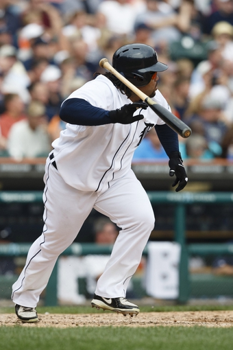Sep 18, 2013; Detroit, MI, USA; Detroit Tigers first baseman Prince Fielder (28) tosses his bat after he hits a double in the fifth inning against the Seattle Mariners at Comerica Park. Mandatory Credit: Rick Osentoski-USA TODAY Sports