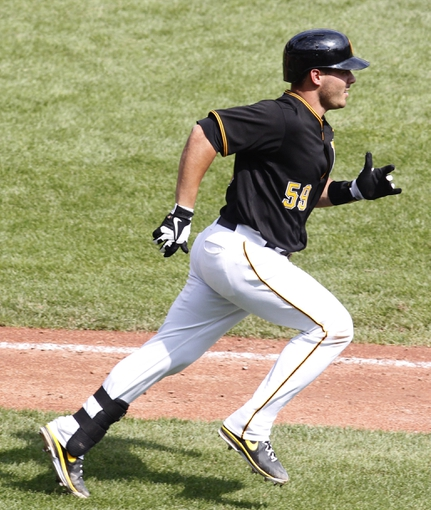 Sep 19, 2013; Pittsburgh, PA, USA; Pittsburgh Pirates catcher Tony Sanchez (59) runs to first base after hitting a single against the San Diego Padres during the fourth inning at PNC Park. Mandatory Credit: Charles LeClaire-USA TODAY Sports