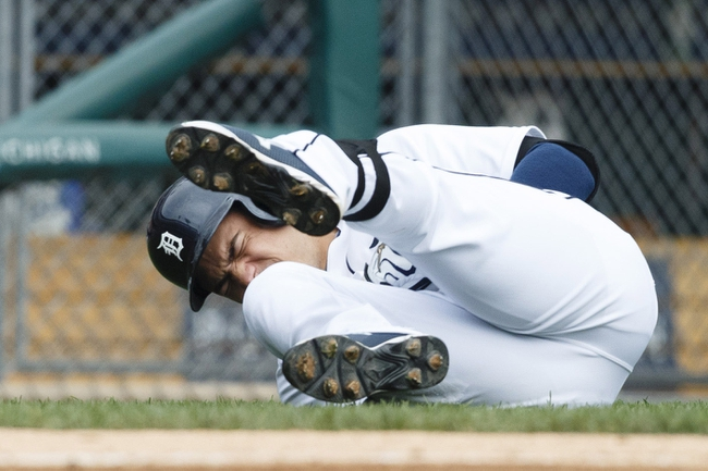 Sep 18, 2013; Detroit, MI, USA; Detroit Tigers shortstop Jose Iglesias (1) reacts after getting hit by a pitch from Seattle Mariners relief pitcher Tom Wilhelmsen (not pictured) in the sixth inning at Comerica Park. Mandatory Credit: Rick Osentoski-USA TODAY Sports