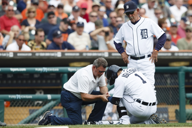 Sep 18, 2013; Detroit, MI, USA; Detroit Tigers trainer Keven Rand and manager Jim Leyland (10) check on shortstop Jose Iglesias (1) after getting hit by a pitch from Seattle Mariners relief pitcher Tom Wilhelmsen (not pictured) in the sixth inning at Comerica Park. Mandatory Credit: Rick Osentoski-USA TODAY Sports