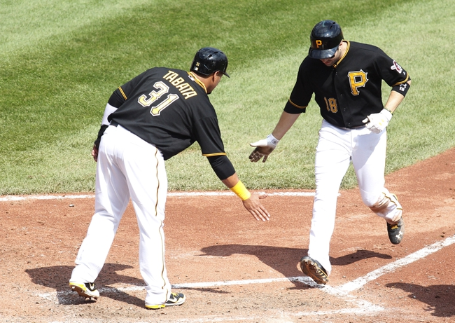 Sep 19, 2013; Pittsburgh, PA, USA; Pittsburgh Pirates left fielder Jose Tabata (31) greets second baseman Neil Walker (18) at home after Walker hit a two run  home run against the San Diego Padres during the fourth inning at PNC Park. Mandatory Credit: Charles LeClaire-USA TODAY Sports