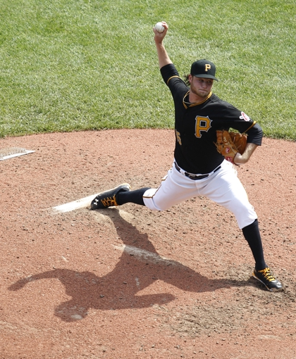 Sep 19, 2013; Pittsburgh, PA, USA; Pittsburgh Pirates starting pitcher Gerrit Cole (45) delivers a pitch against the San Diego Padres during the fifth inning  at PNC Park. Mandatory Credit: Charles LeClaire-USA TODAY Sports