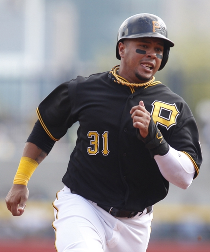 Sep 19, 2013; Pittsburgh, PA, USA; Pittsburgh Pirates left fielder Jose Tabata (31) runs from first to third against the San Diego Padres during the sixth inning at PNC Park. Mandatory Credit: Charles LeClaire-USA TODAY Sports
