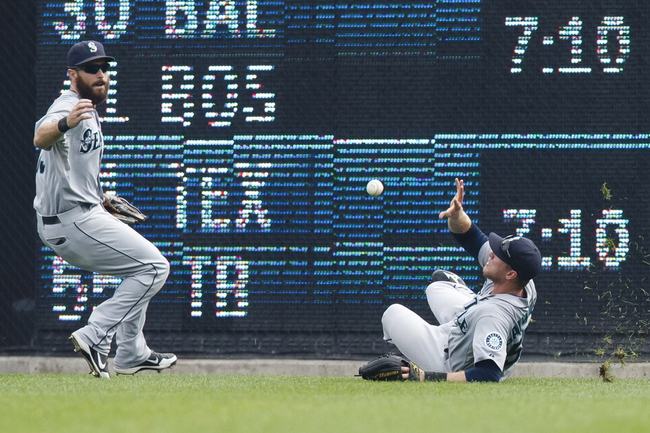 Sep 18, 2013; Detroit, MI, USA; Seattle Mariners center fielder Michael Saunders (55) bare hands a ball hit by Detroit Tigers right fielder Torii Hunter (not pictured) for a double in the seventh inning at Comerica Park. Mandatory Credit: Rick Osentoski-USA TODAY Sports