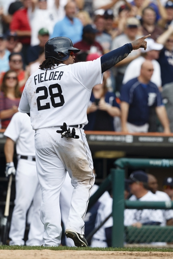 Sep 18, 2013; Detroit, MI, USA; Detroit Tigers first baseman Prince Fielder (28) points toward catcher Victor Martinez (not pictured) after he scores a run on an RBI double hit by Martinez in the seventh inning against the Seattle Mariners at Comerica Park. Mandatory Credit: Rick Osentoski-USA TODAY Sports