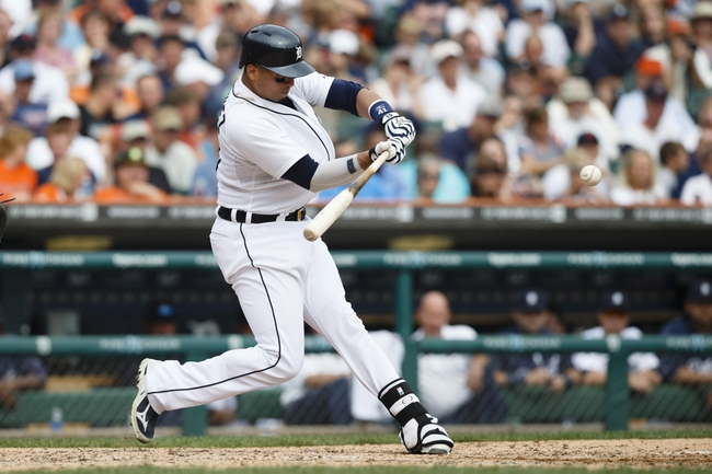 Sep 18, 2013; Detroit, MI, USA; Detroit Tigers catcher Victor Martinez (41) hits an RBI double in the seventh inning against the Seattle Mariners at Comerica Park. Mandatory Credit: Rick Osentoski-USA TODAY Sports