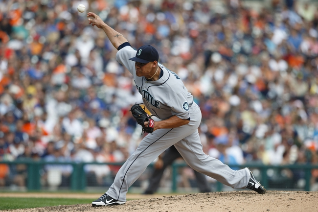Sep 18, 2013; Detroit, MI, USA; Seattle Mariners relief pitcher Yoervis Medina (31) pitches in the eighth inning against the Detroit Tigers at Comerica Park. Detroit won 5-4. Mandatory Credit: Rick Osentoski-USA TODAY Sports