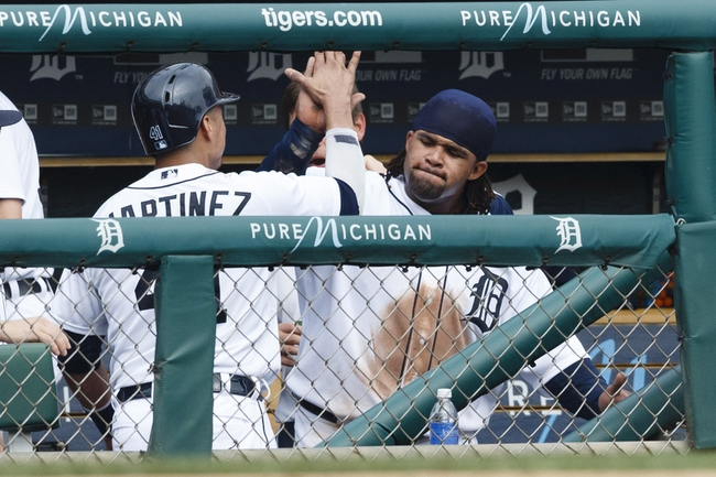 Sep 18, 2013; Detroit, MI, USA; Detroit Tigers catcher Victor Martinez (41) high fives with first baseman Prince Fielder (28) in the dugout during the seventh inning against the Seattle Mariners at Comerica Park. Detroit won 5-4. Mandatory Credit: Rick Osentoski-USA TODAY Sports
