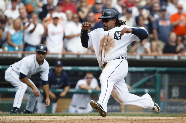 Sep 18, 2013; Detroit, MI, USA; Detroit Tigers first baseman Prince Fielder (28) scores a run on  an RBI double hit by catcher Victor Martinez (not pictured) in the seventh inning against the Seattle Mariners at Comerica Park. Mandatory Credit: Rick Osentoski-USA TODAY Sports