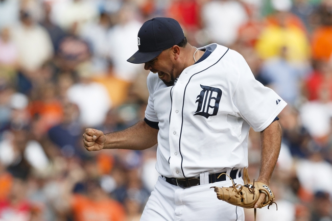 Sep 18, 2013; Detroit, MI, USA; Detroit Tigers relief pitcher Joaquin Benoit (53) pumps his fist after striking out Seattle Mariners center fielder Dustin Ackley (not pictured) for the last out in the ninth inning at Comerica Park. Detroit won 5-4. Mandatory Credit: Rick Osentoski-USA TODAY Sports