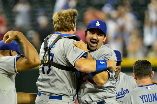 Sep 19, 2013; Phoenix, AZ, USA; (Editors note: Caption correction) Los Angeles Dodgers catcher A.J. Ellis (17) celebrates with first baseman Adrian Gonzalez (23) after beating the Arizona Diamondbacks 7-6 at Chase Field. Mandatory Credit: Matt Kartozian-USA TODAY Sports