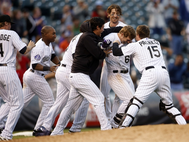 Sep 19, 2013; Denver, CO, USA; Members of the Colorado Rockies celebrate with center fielder Corey Dickerson (6) after he hit a walk off triple to win the game during the fifthteenth inning against the St. Louis Cardinals  at Coors Field. The Rockies won 7-6 in 15 innings.  Mandatory Credit: Chris Humphreys-USA TODAY Sports