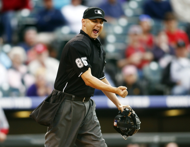 Sep 19, 2013; Denver, CO, USA; Home plate umpire Vic Carapazza (85) calls out Colorado Rockies second baseman Jonathan Herrera (not pictured) during the twelfth inning against the St. Louis Cardinals at Coors Field. The Rockies won 7-6 in 15 innings.  Mandatory Credit: Chris Humphreys-USA TODAY Sports