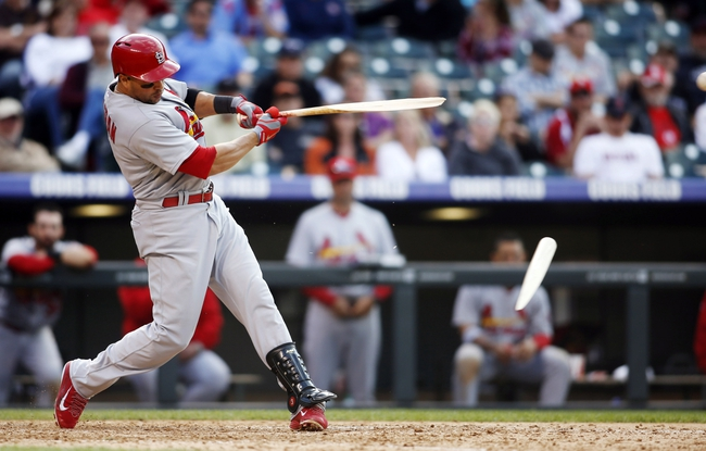 Sep 19, 2013; Denver, CO, USA; St. Louis Cardinals right fielder Carlos Beltran (3) breaks his bat during the twelfth inning against the Colorado Rockies at Coors Field. The Rockies won 7-6 in 15 innings.  Mandatory Credit: Chris Humphreys-USA TODAY Sports