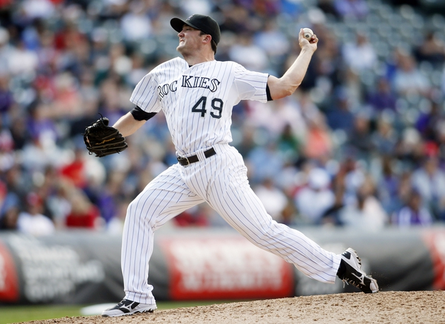 Sep 19, 2013; Denver, CO, USA; Colorado Rockies pitcher Rex Brothers (49) delivers a pitch during the ninth inning against the St. Louis Cardinals at Coors Field. The Rockies won 7-6 in 15 innings.  Mandatory Credit: Chris Humphreys-USA TODAY Sports