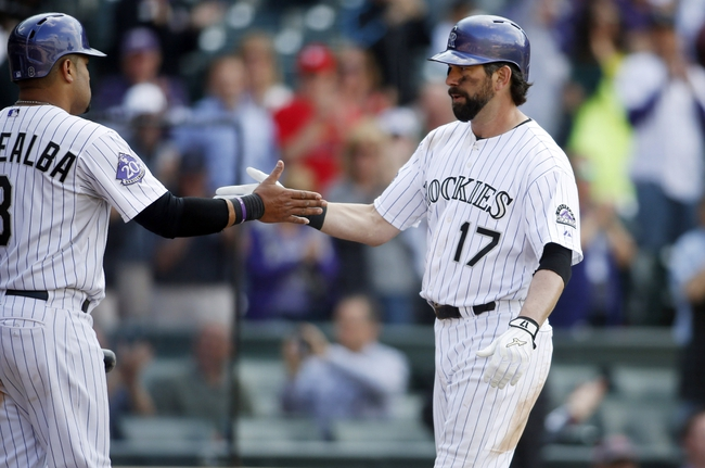 Sep 19, 2013; Denver, CO, USA; Colorado Rockies first baseman Todd Helton (17) celebrates with catcher Yorvit Torrealba (8) after hitting a game tying home run during the ninth inning against the St. Louis Cardinals at Coors Field. The Rockies won 7-6 in 15 innings.  Mandatory Credit: Chris Humphreys-USA TODAY Sports