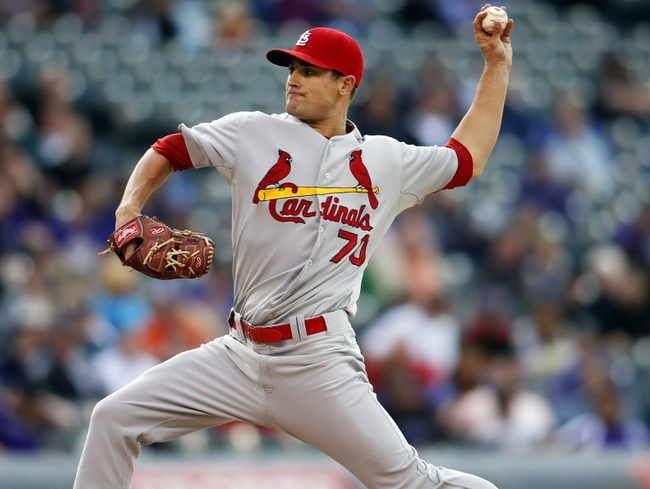 Sep 19, 2013; Denver, CO, USA; St. Louis Cardinals pitcher Tyler Lyon (70) delivers a pitch during the tenth inning against the St. Louis Cardinals at Coors Field. The Rockies won 7-6 in 15 innings.  Mandatory Credit: Chris Humphreys-USA TODAY Sports