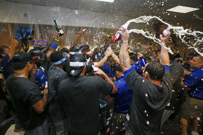Sep 19, 2013; Phoenix, AZ, USA; Los Angeles Dodgers players celebrate in the clubhouse after defeating the Arizona Diamondbacks 7-6 to clinch the NL West title at Chase Field. Mandatory Credit: Rob Schumacher/The Arizona Republic-USA TODAY Sports