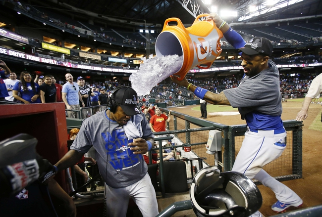 Sep 19, 2013; Phoenix, AZ, USA; Los Angeles Dodgers center fielder Matt Kemp (right) dumps gatorade on Hanley Ramirez (left) after defeating the Arizona Diamondbacks 7-6 to clinch the NL West title at Chase Field. Mandatory Credit: Rob Schumacher/The Arizona Republic-USA TODAY Sports
