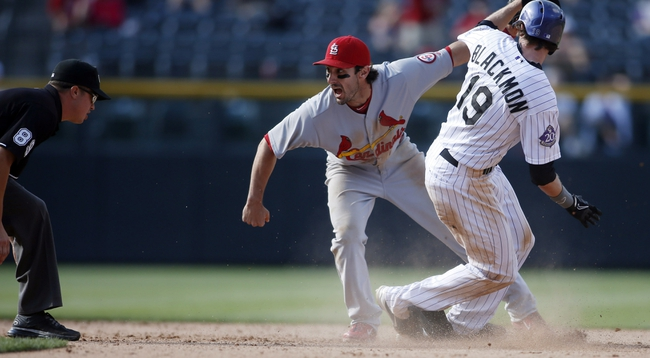 Sep 19, 2013; Denver, CO, USA; Colorado Rockies right fielder Charlie Blackmon (19) beats the tag by St. Louis Cardinals second baseman Matt Carpenter (13) for a double during the eighth inning at Coors Field. The Rockies won 7-6 in 15 innings.  Mandatory Credit: Chris Humphreys-USA TODAY Sports