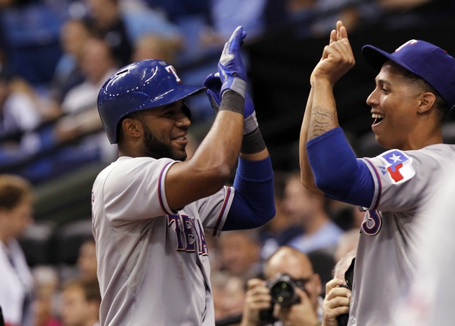 Sep 19, 2013; St. Petersburg, FL, USA; Texas Rangers shortstop Elvis Andrus (1) is congratulated  by center fielder Leonys Martin (2) after he hit a solo home run during the third inning against the Tampa Bay Rays at Tropicana Field. Mandatory Credit: Kim Klement-USA TODAY Sports