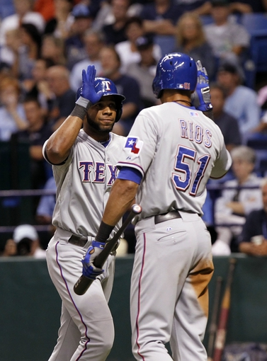 Sep 19, 2013; St. Petersburg, FL, USA; Texas Rangers shortstop Elvis Andrus (1) is congratulated by Texas Rangers right fielder Alex Rios (51) after he hit a solo home run during the third inning against the Tampa Bay Rays at Tropicana Field. Mandatory Credit: Kim Klement-USA TODAY Sports