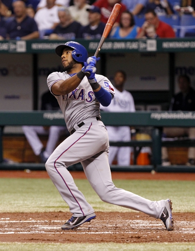Sep 19, 2013; St. Petersburg, FL, USA; Texas Rangers shortstop Elvis Andrus (1) hits a solo home run during the third inning against the Tampa Bay Rays at Tropicana Field. Mandatory Credit: Kim Klement-USA TODAY Sports