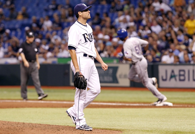Sep 19, 2013; St. Petersburg, FL, USA; Tampa Bay Rays starting pitcher Matt Moore (55) reacts after he gave up his third home run to Texas Rangers right fielder Alex Rios (51) during the third inning at Tropicana Field. Mandatory Credit: Kim Klement-USA TODAY Sports
