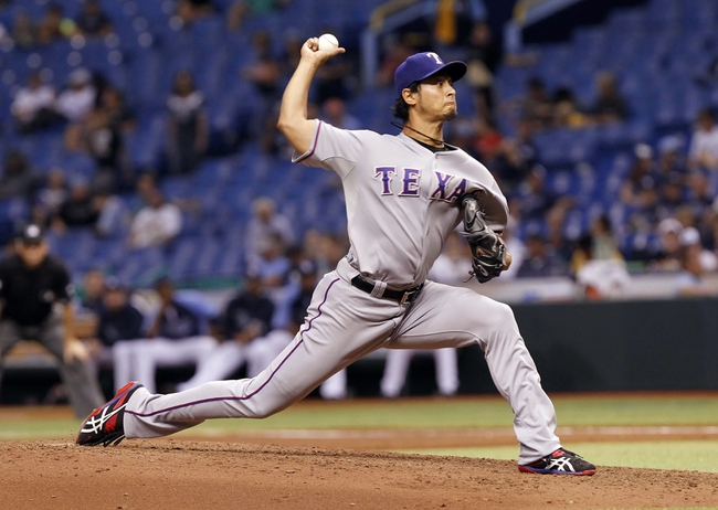 Sep 19, 2013; St. Petersburg, FL, USA; Texas Rangers starting pitcher Yu Darvish (11) throws a pitch during the third inning against the Tampa Bay Rays at Tropicana Field. Mandatory Credit: Kim Klement-USA TODAY Sports