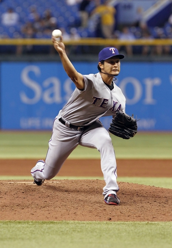 Sep 19, 2013; St. Petersburg, FL, USA; Texas Rangers starting pitcher Yu Darvish (11) throws a pitch during the fifth inning against the Tampa Bay Rays at Tropicana Field. Mandatory Credit: Kim Klement-USA TODAY Sports