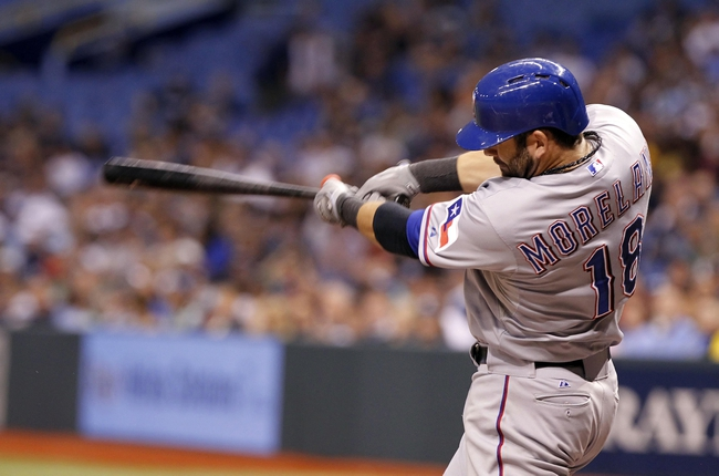 Sep 19, 2013; St. Petersburg, FL, USA; Texas Rangers first baseman Mitch Moreland (18) singles during the sixth inning against the Tampa Bay Rays at Tropicana Field. Mandatory Credit: Kim Klement-USA TODAY Sports