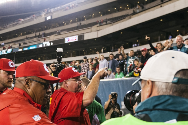 Sep 19, 2013; Philadelphia, PA, USA; Kansas City Chiefs head coach Andy Reid waves to fans as he leaves the field after defeating the Philadelphia Eagles at Lincoln Financial Field. The Chiefs defeated the Eagles 26-16. Mandatory Credit: Howard Smith-USA TODAY Sports